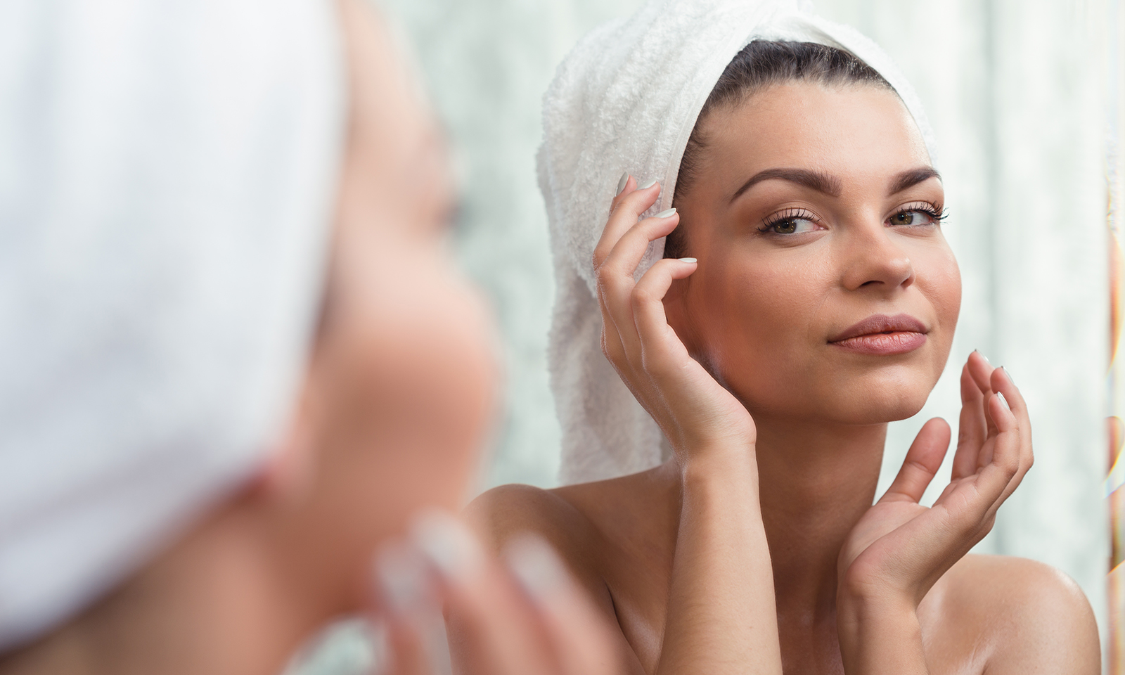 woman-looking-in-mirror-at-face-with-no-makeup-main-image