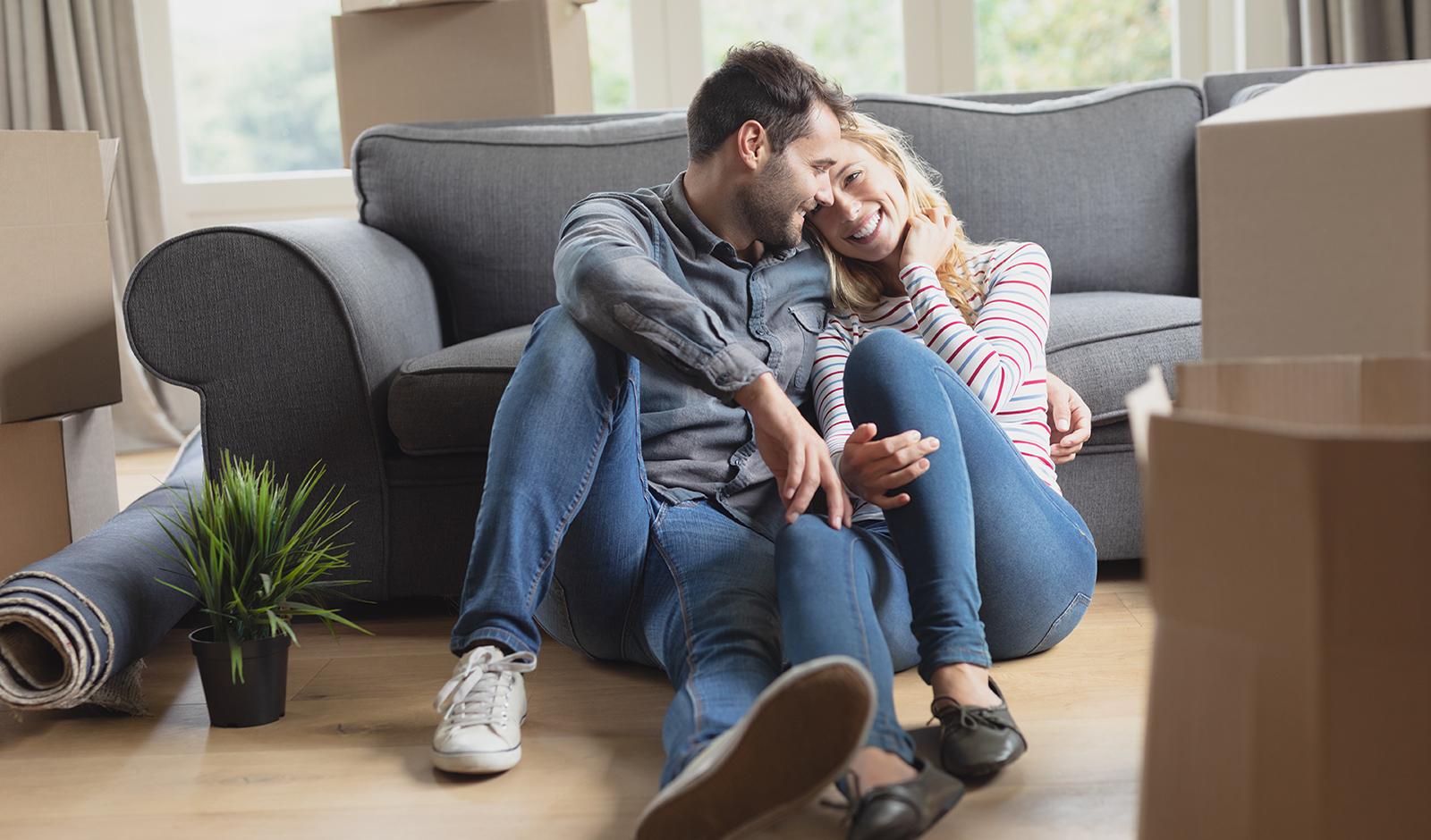 couple-cuddling-on-living-room-floor