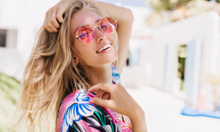 woman-in-cute-pink-sunglasses-smiling