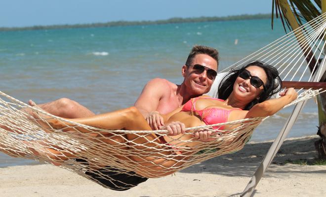 romantic getaway Kuaui, Hawaii Candace Kita and Doug Jeffries on the beach in a hammock