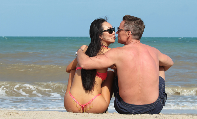romantic getaway Kuaui, Hawaii Candace Kita and Doug Jeffries on the beach kissing