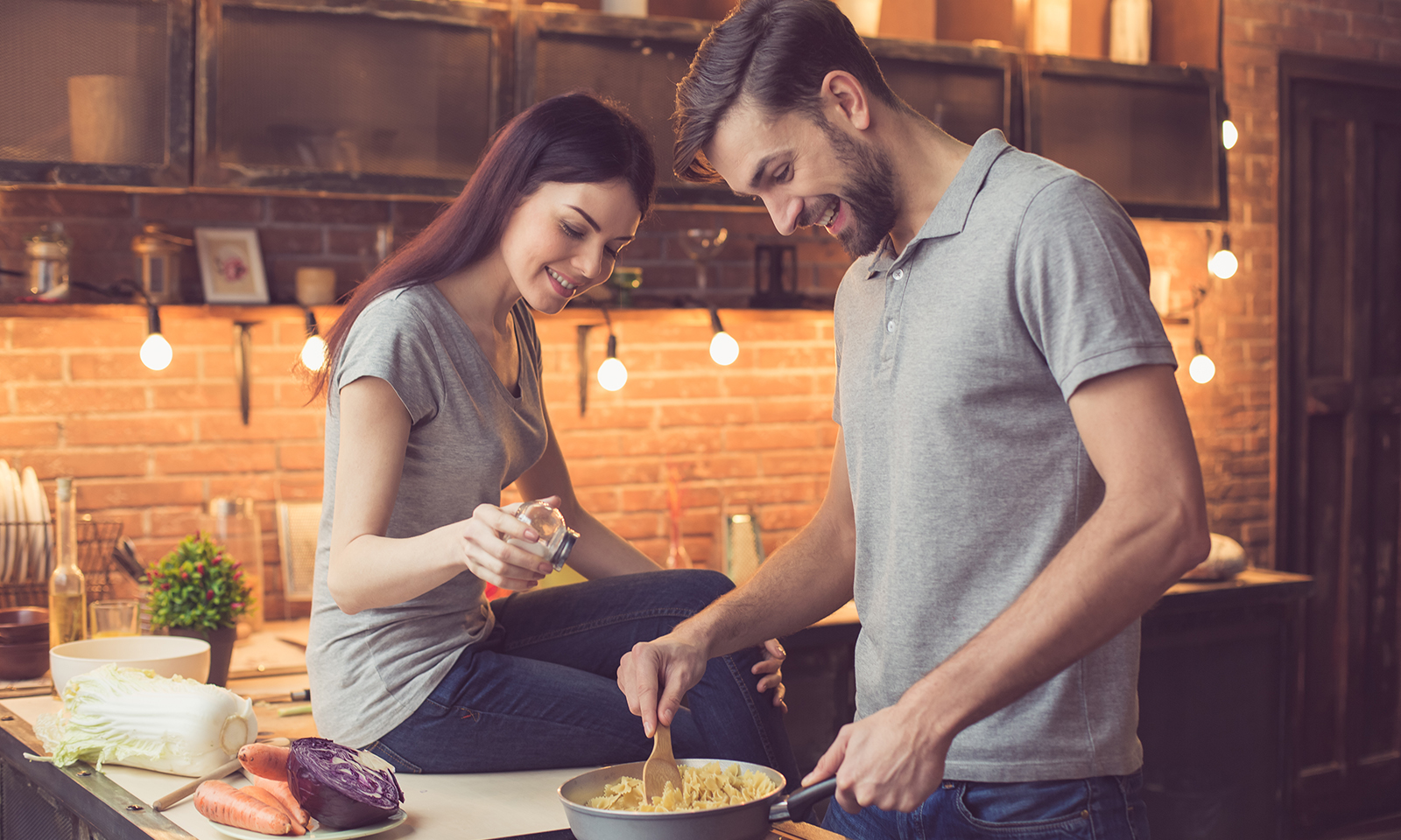 couple-in-the-kitchen-making-dinner