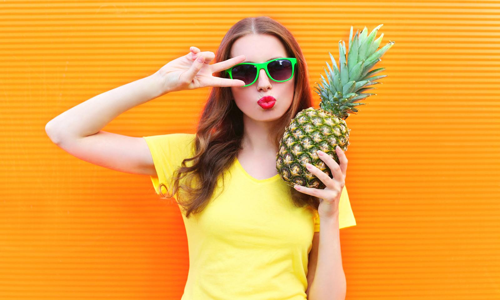 AdobeStock_vegan_woman_pineapple_sunnies_sunglasses_yellow_orange