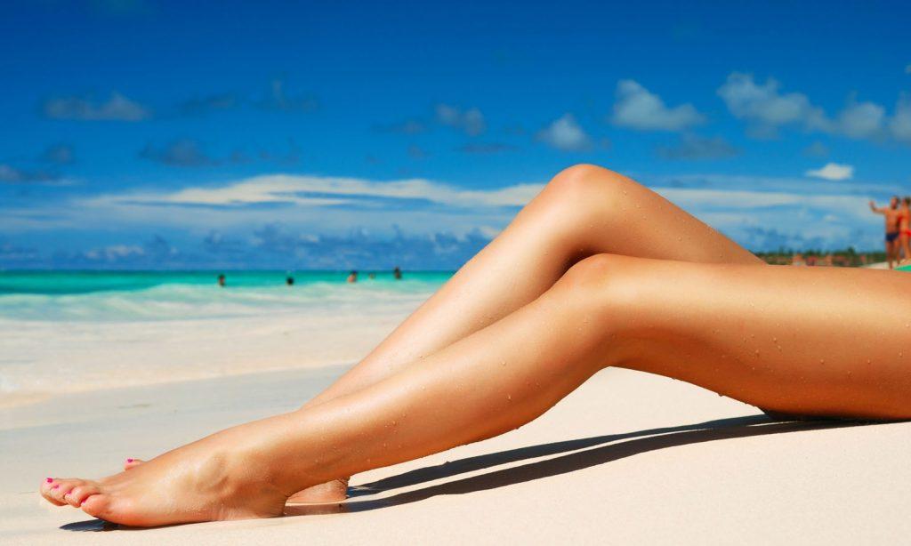 legs on beach Beauty Editor Candace Kita's Summer Beauty Essentials main image