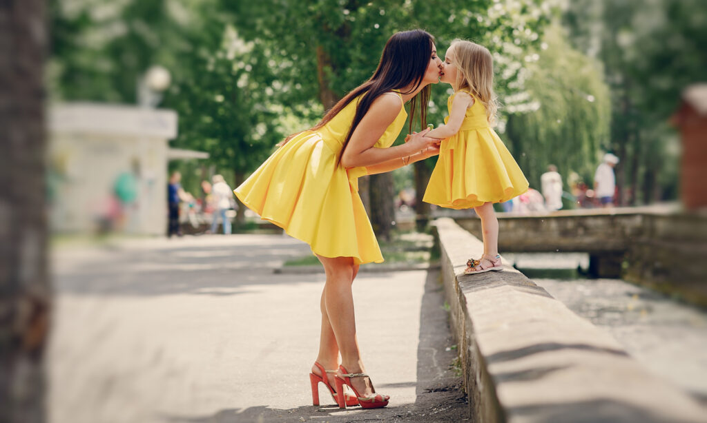 AdobeStock_143524662-woman-kissing-girl-child-yellow-dress-better-person-mother-daughter, How to Be a Better Person in 4 Simple Steps