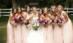 bride and bridesmaids together 100 years of bridesmaid dresses main image