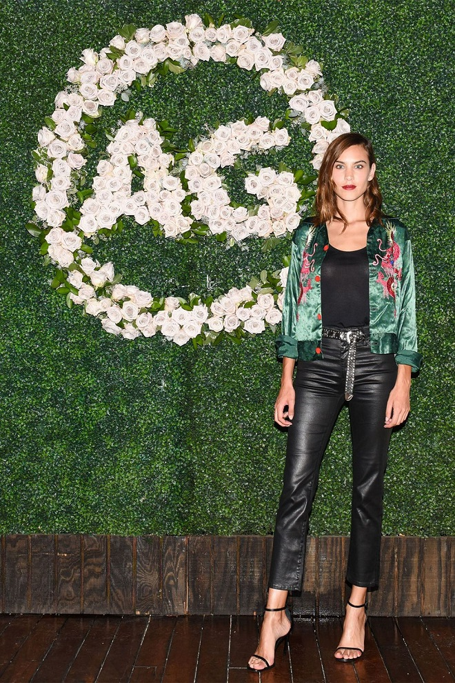 22 Examples of Alexa Chung Style We Love black leather pants green jacket