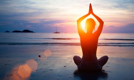 Woman on Beach Top 5 Benefits of Hot Yoga Main Image