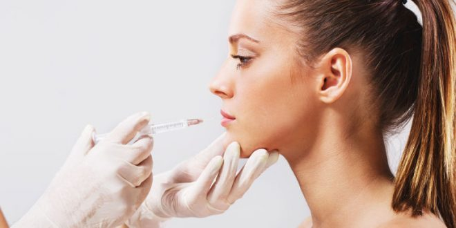 woman-getting-lip-injections-fillers-cosmetic-procedure
