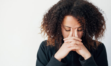 woman-with-head-in-her-hands-sad-depression-thinking