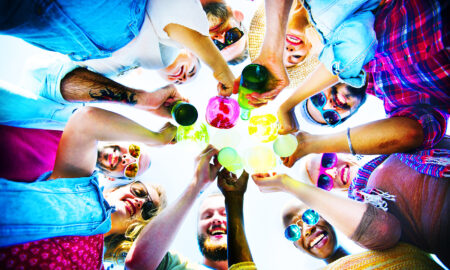 group-of-friends-toasting-with-colorful-drinks