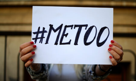 #metoo-woman-holding-up-me-too-sign