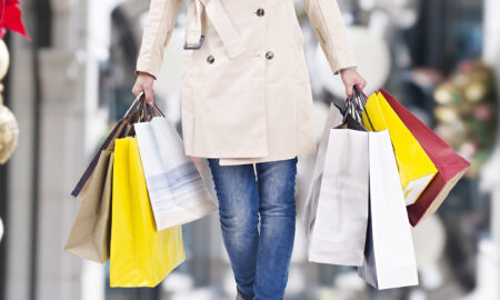 woman-in-a-coat-holding-shopping-bags