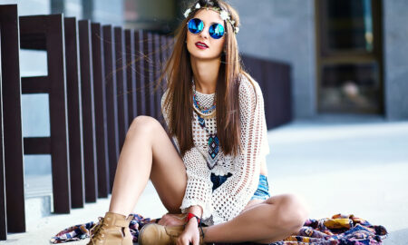woman-in-flower-crown-and-sunglasses-sits-on-the-street-stylish