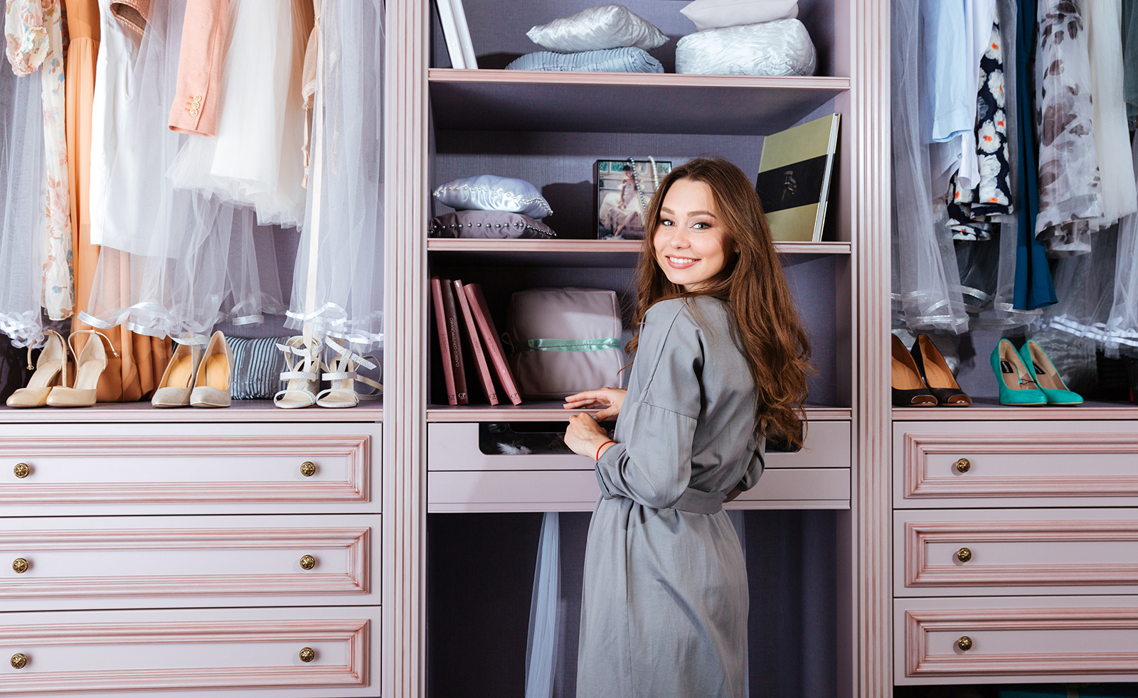 woman-standing-by-her-wardrobe-walk-in-closet