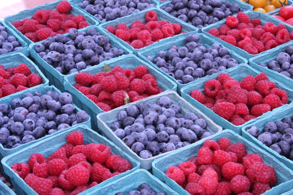square-shaped blue containers filled with raspberries and blue berries, 6 Plant Foods that Boost Your Metabolism