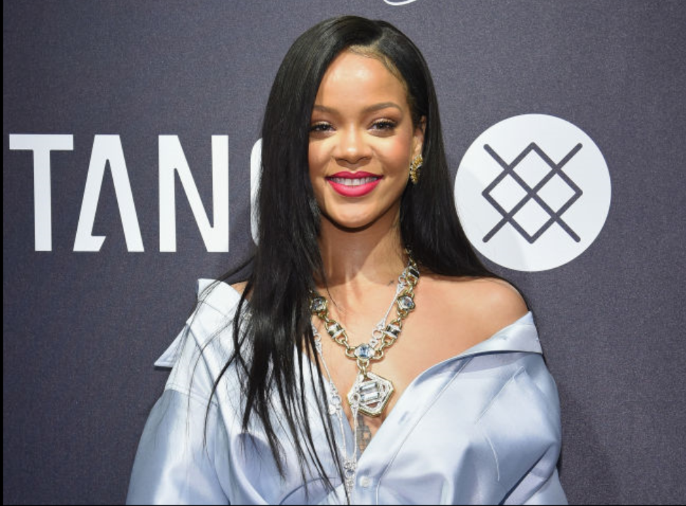 Rihanna Turns Heads In Plunging Shirt Dress