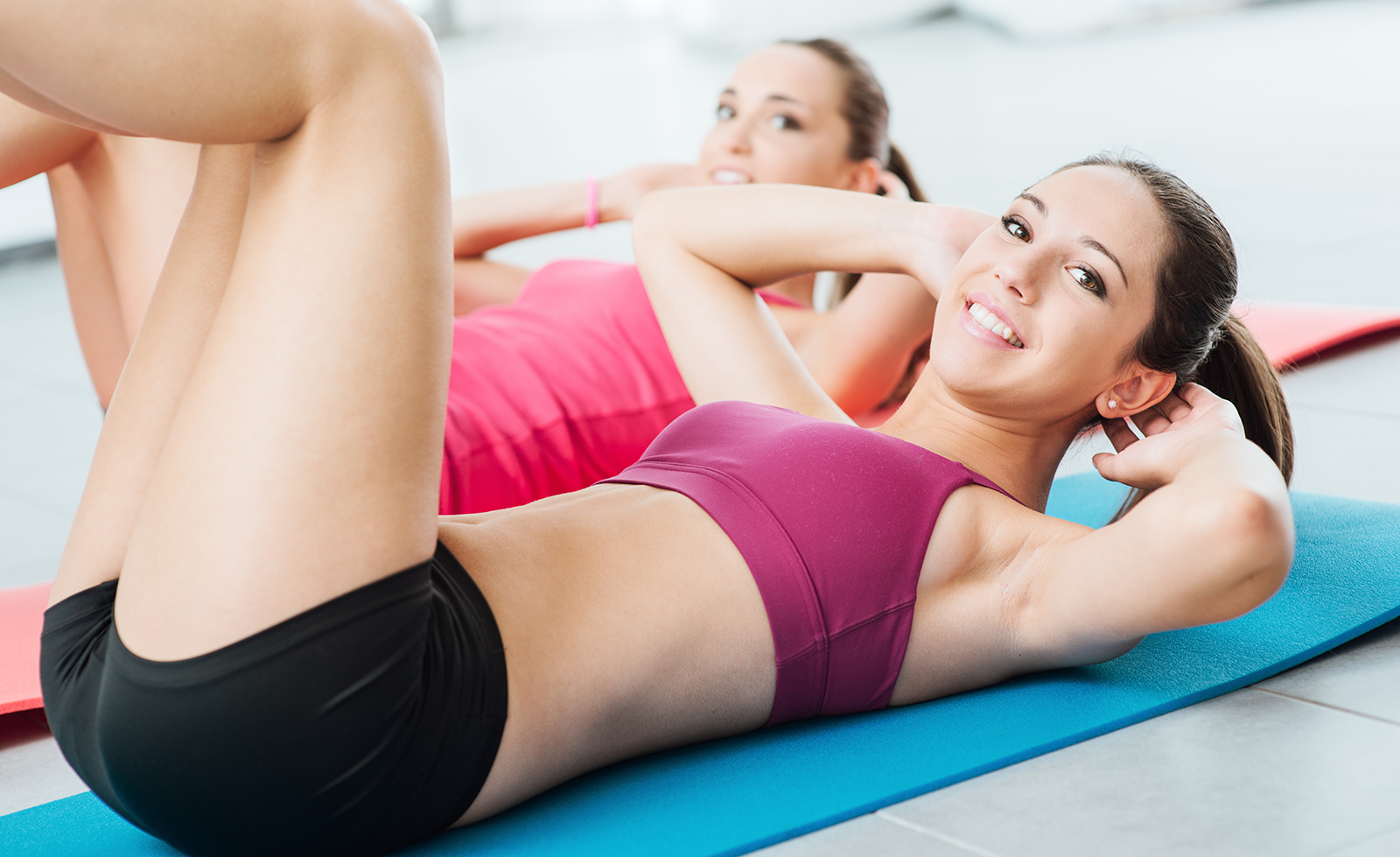 two-women-in-fitness-class-fit-workout