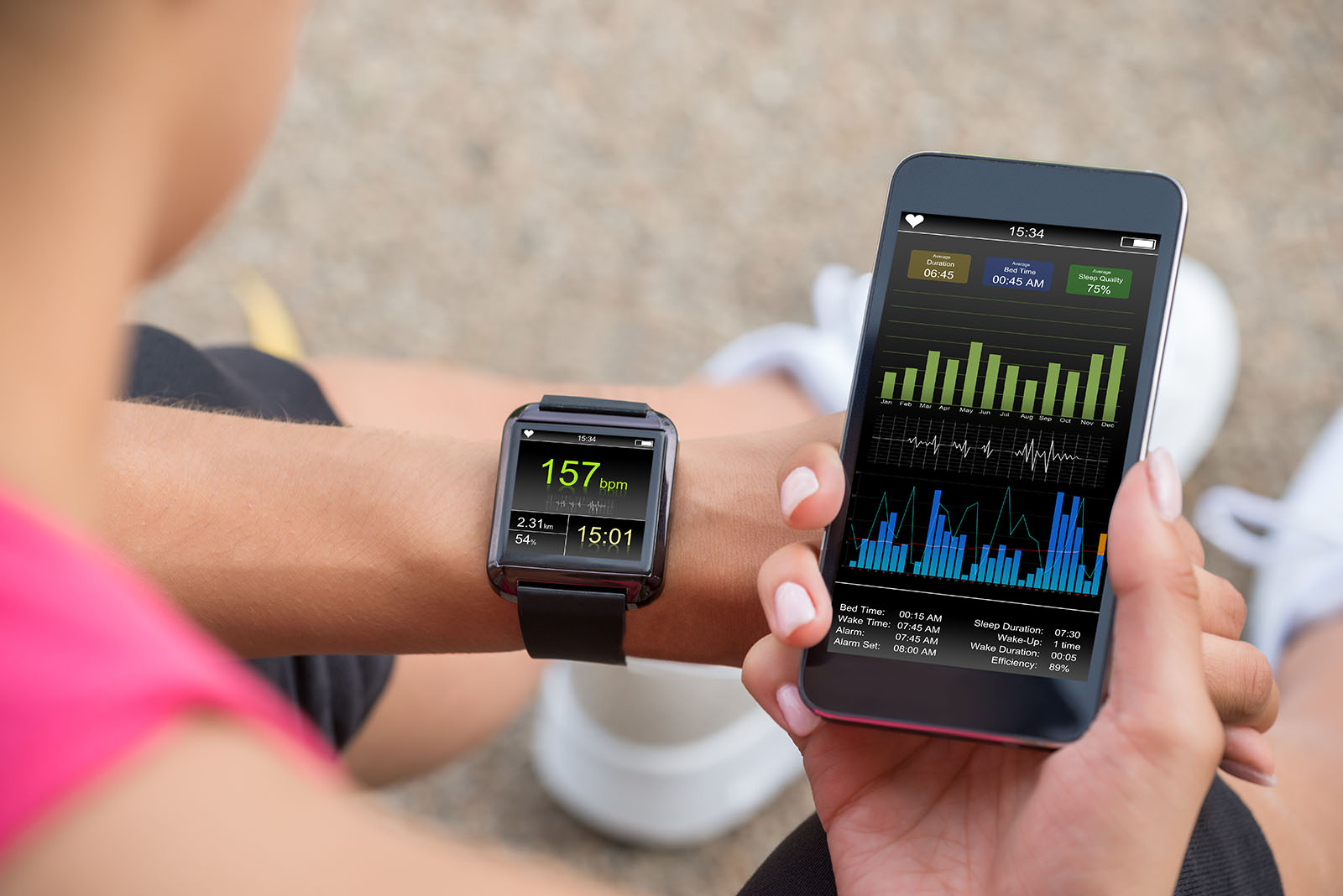 Running Female With Mobile Phone Connected To A Smart Watch