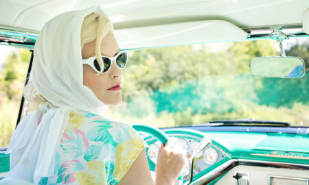 1960s classic car with beautiful blonde woman