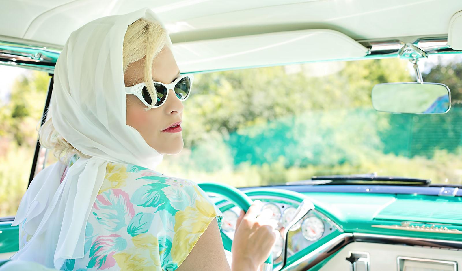 vintage-woman-driving-vintage-car-on-road-during-daytime-33678