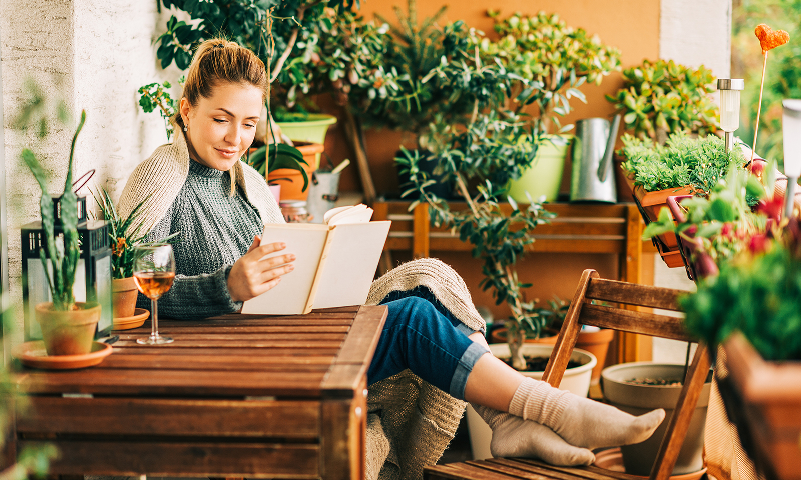 benefits-of-reading-woman-sitting-at-home-reading-a-book