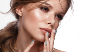 facial-serums-for-perfect-skin-woman-with-beautiful-complexion-touching-face-main-image
