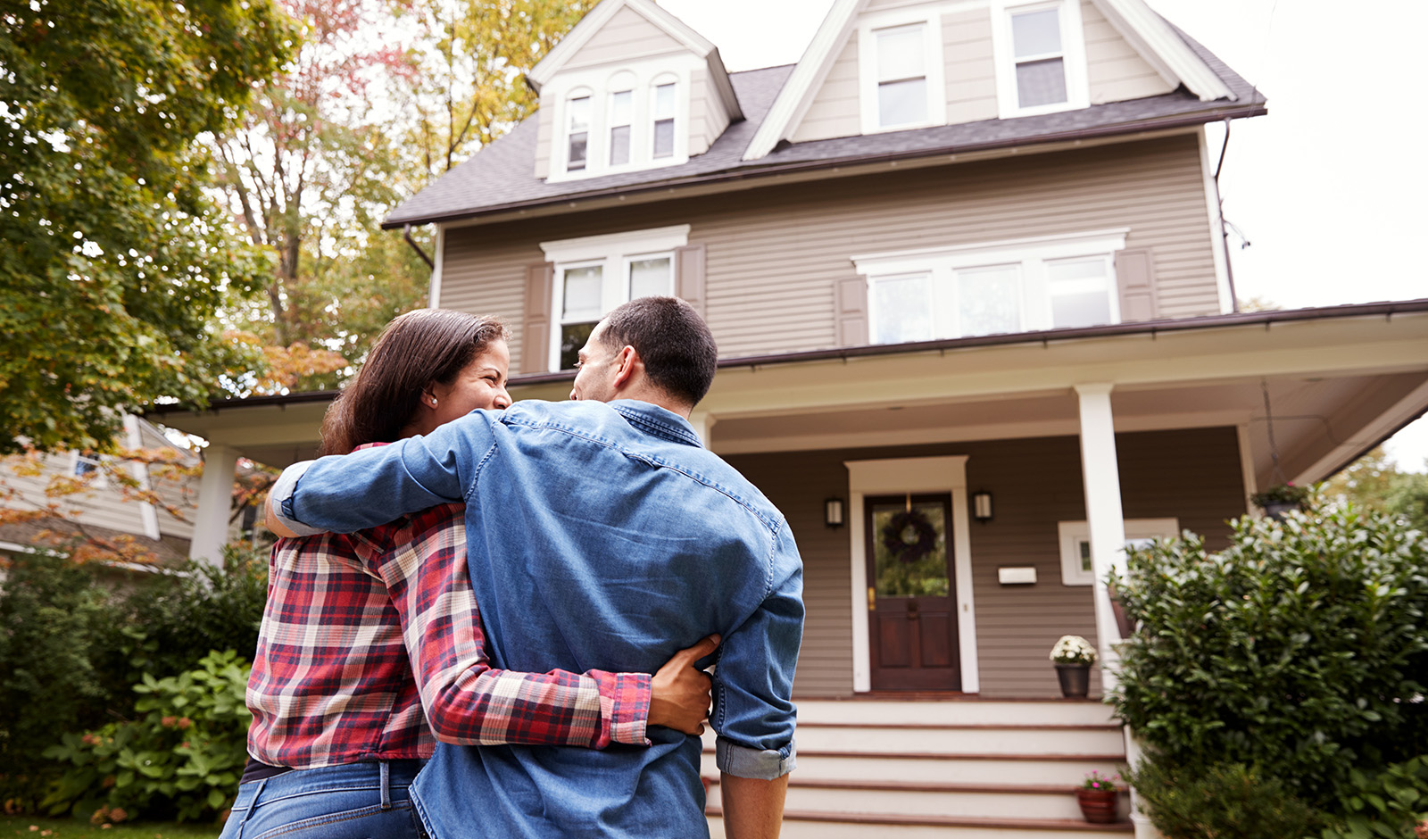 incoprorate-luxury-into-your-home-main-image-happy-couple-outside-new-home