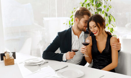 kittenfishing-dating-trend-why-its-so-dangerous-couple-enjoying-wine-at-table
