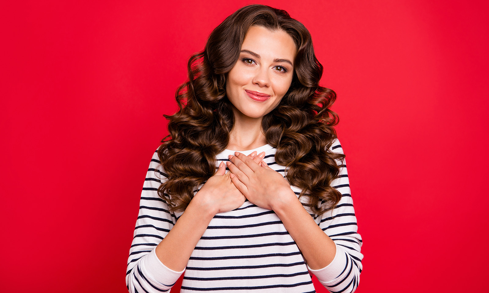 4-signs-youre-a-highly-sensitive-person-woman-holding-her-chest-showing-gratitude-and-emotion