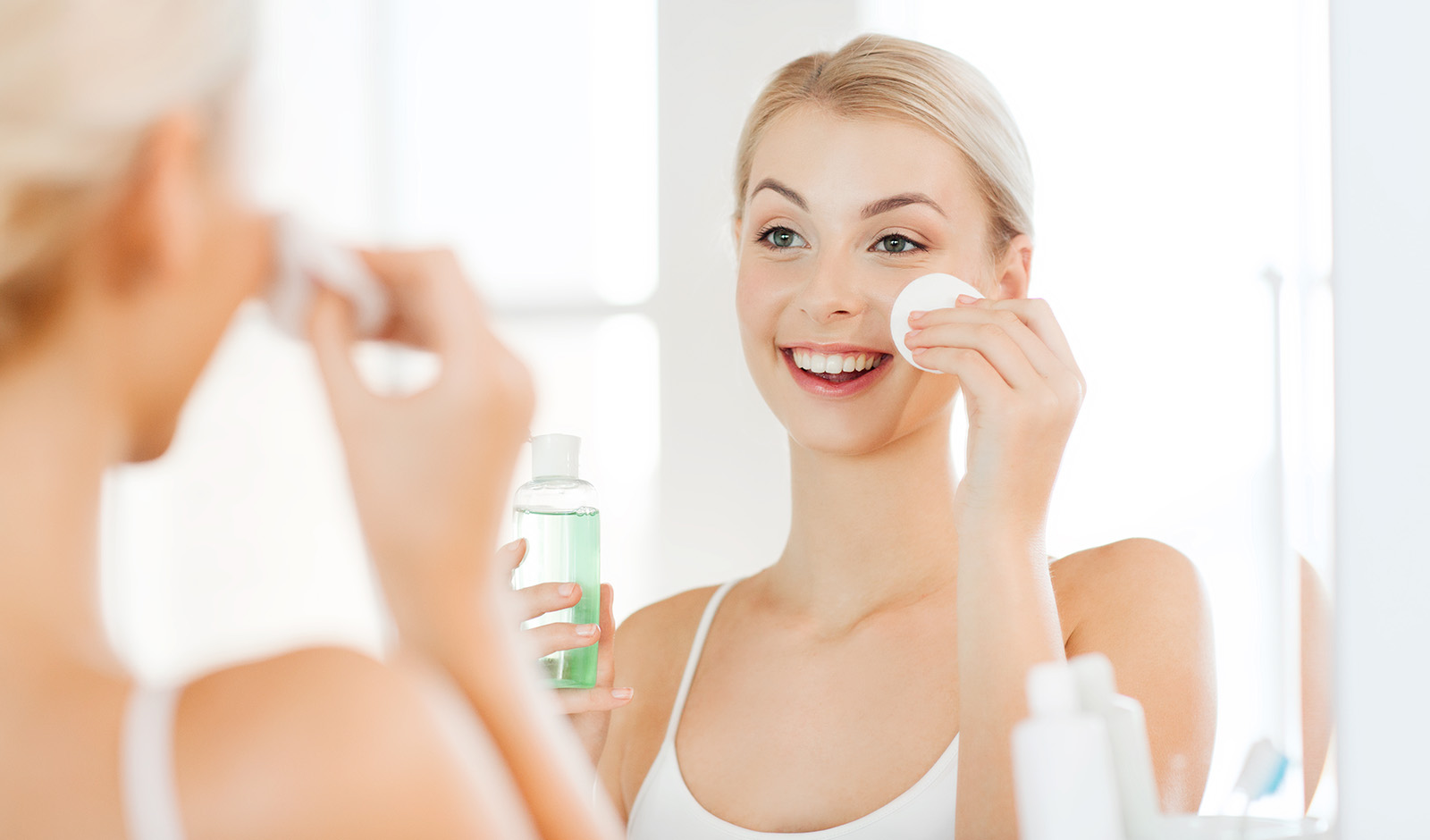 hyaluronic-acid-the-ingredient-you're-missing-in-your-skincare-main-image-woman-applying-product-to-skin