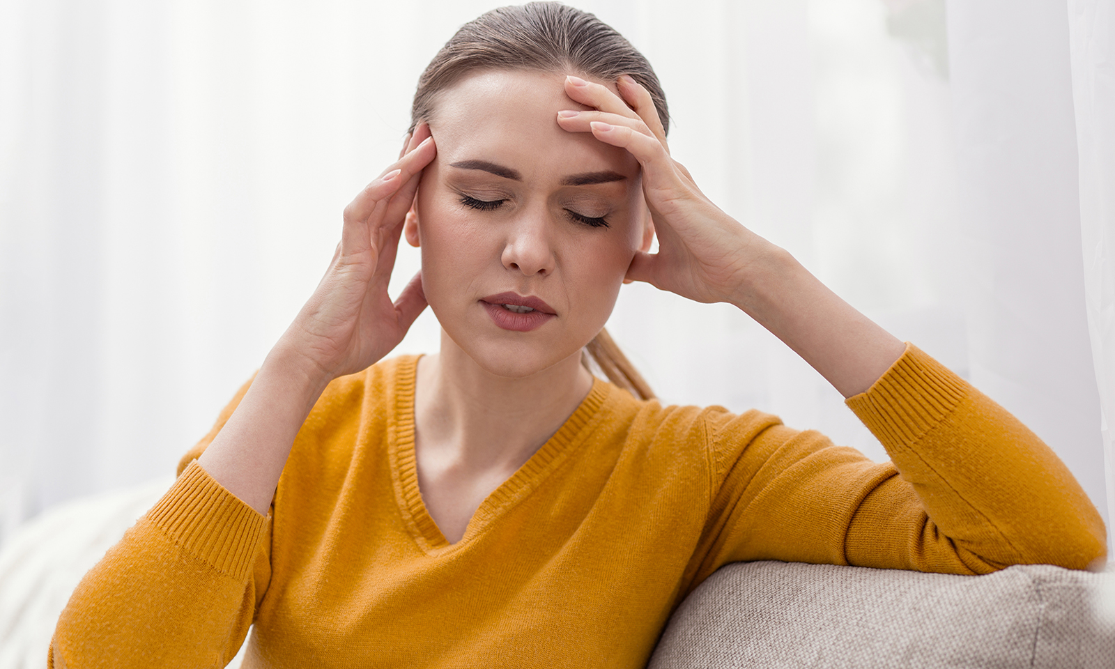 rise-of-depression-due-to-social-media-main-image-woman-in-pain-headache