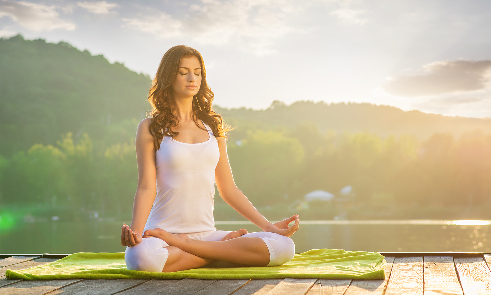 the-power-of-affirmations-beautiful-young-woman-meditating-on-a-dock