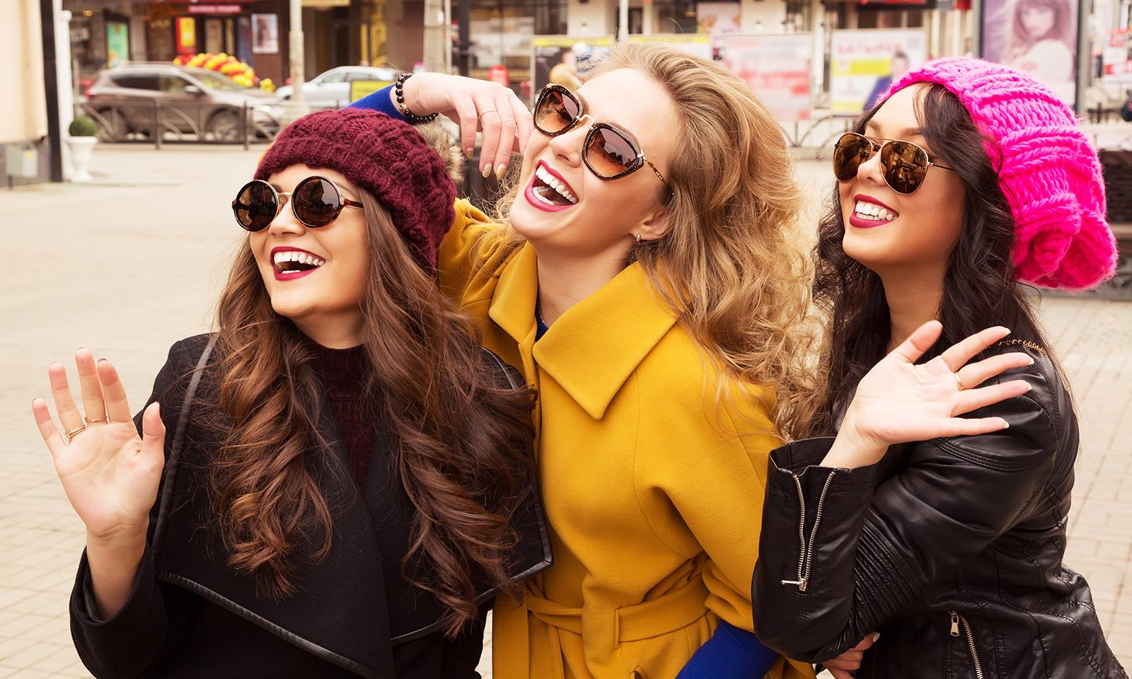 three-friends-waving-colorful-playful-fun-girlfriends