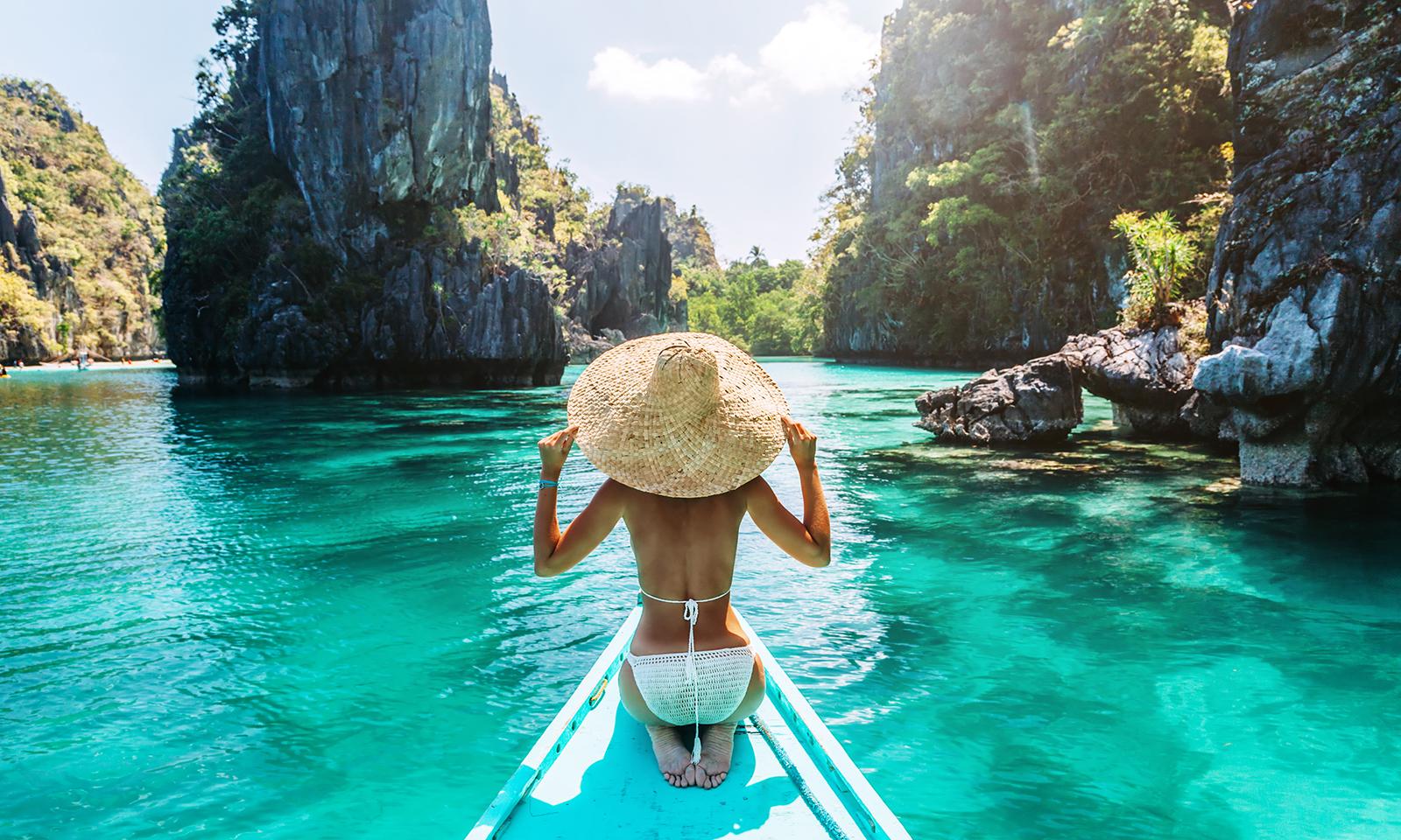 travel-girl-in-boat-in-southeast-asia-beautiful-water-bikini