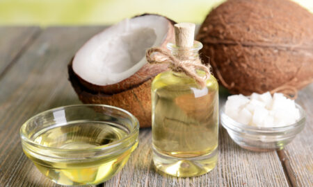 essential-oils-to-promote-a-happy-state-of-mind-coconut-and-essential-oils-laid-out-together (1)
