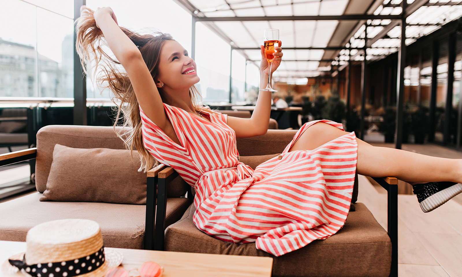 how-to-naturally-boost-oxytocin-happy-girl-enjoying-a-drink