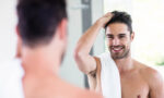 reasons-men-should-use-body-grooming-devices-man-shaving-looking-in-mirror