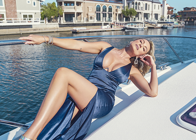 amber-nichole-miller-Shawn-Ferjanic-photoshoot-model-leaning-against-boat-in-blue-dress-image-6
