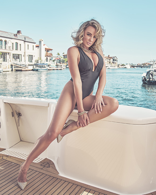 amber-nichole-miller-Shawn-Ferjanic-photoshoot-model-sitting-on-boat-in-water-image-4