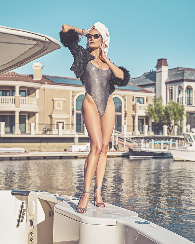 amber-nichole-miller-Shawn-Ferjanic-photoshoot-model-standing-on-boat-in-water-image-2