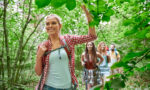 ways-to-get-healthier-today-friends-walking-through-the-woods-greenery