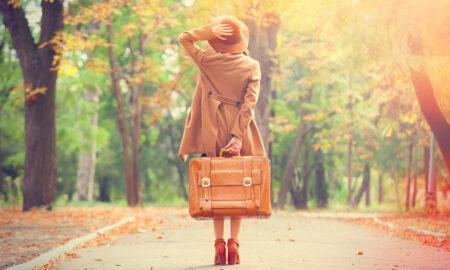 International-fashion-blogs-you-must-follow-woman-walking-through-street-in-fall-fashionable