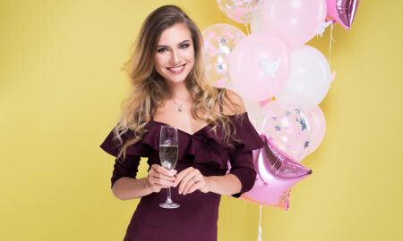 champagne-cocktails-worthy-of-a-girls-night-in-main-image-woman-holding-champagne-celebrating