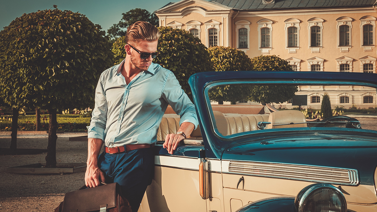 how-to-get-your-dad-to-dress-better-main-image-fashionable-man-standing-by-car