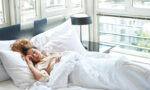 natural-remedies-to-help-you-sleep-better-woman-in-white-bed-sleeping