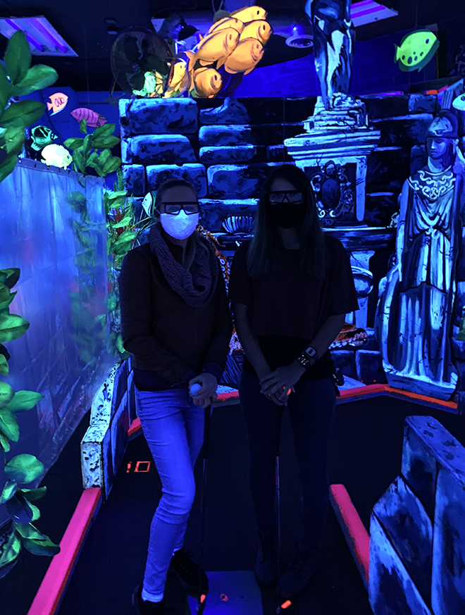 3d-blacklight-mini-golf-malorie-mackey-elizabeth-saint-king-neptunes-3d-mini-golf