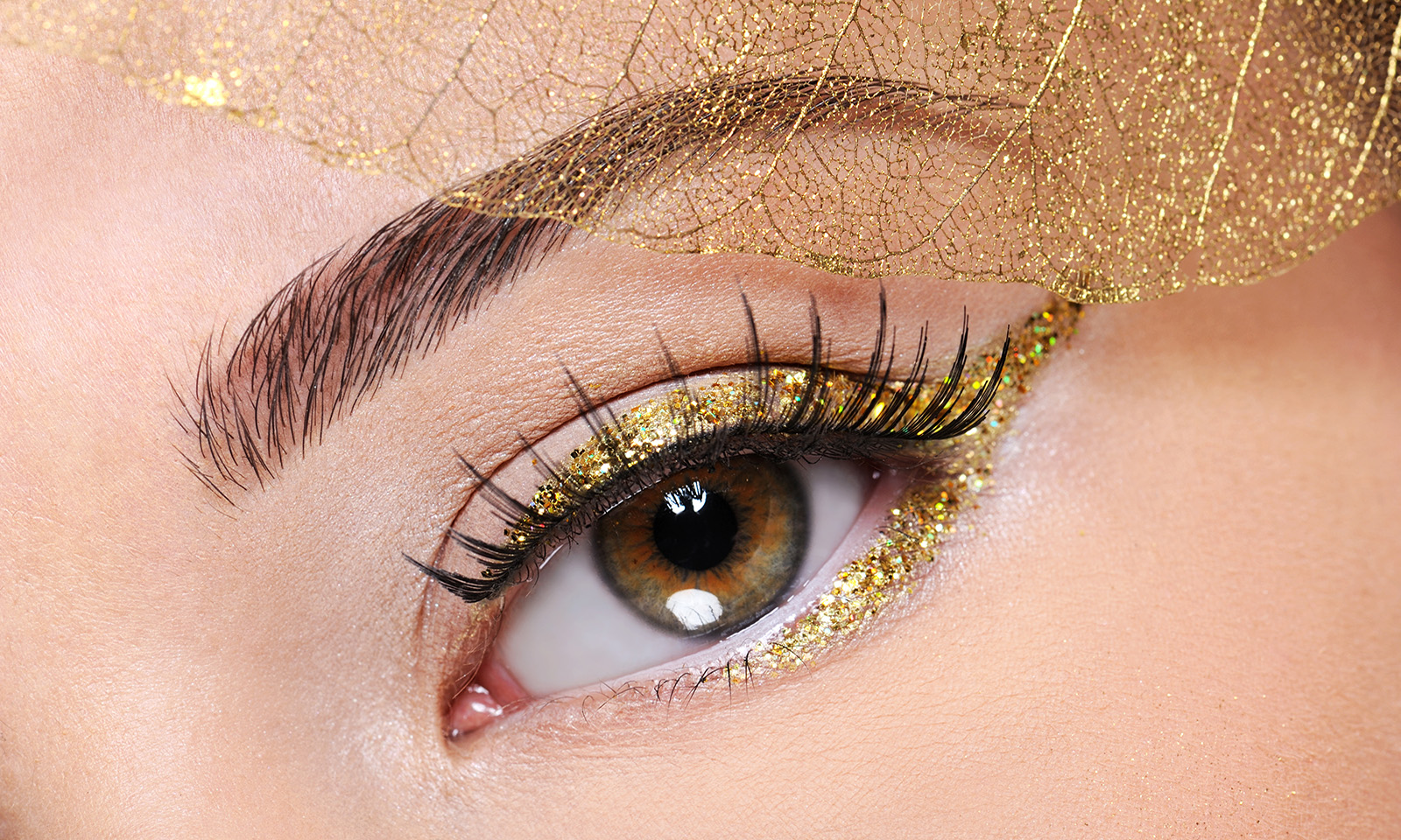 eyeliner-tricks-every-glam-girl-should-know-woman-wearing-gold-eyeliner