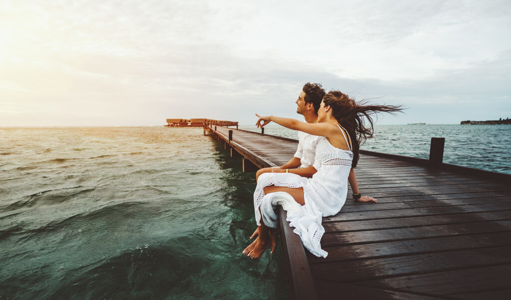 how-to-protect-yourself-when-dating-in-2020-couple-sitting-on-dock
