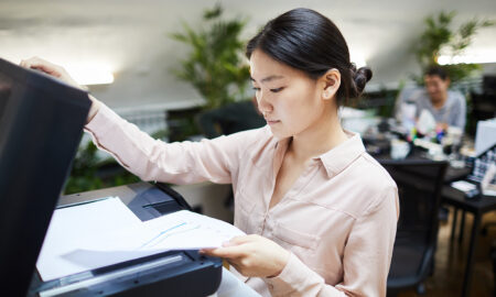 officejet-printers-maintaining-and-advantages-woman-using-scanner-on-printer